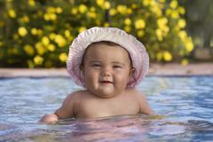 baby swim in a pool - stock photo