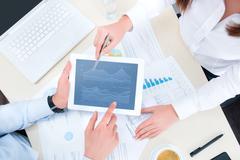 Analyzing financial chart Stock Photos