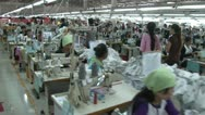 Textile Garment Factory Workers: WS stabilized follow group through factory Stock Footage