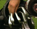 Stock Video Footage of GOLF iron picked by hand