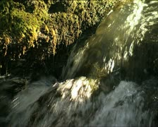 WATER flowing with sun reflections Stock Footage