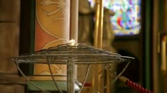 Candles in Notre-Dame in Paris Stock Footage