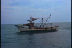 Fishing boat in the Adriatic Sea, gray sky, boat bobbing on sea Stock Footage