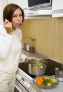 Young woman prepare meal - stock photo