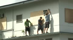 Preparing For Hurricane Boarding Up Windows - stock footage