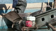 Fishing loading fish from boat to conveyor belt HD 0801 Stock Footage