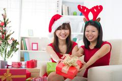 asian friends christmas celebration , chinese south east asian ethnicity - stock photo