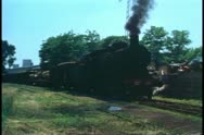 A steam locomotive in the industrial town of Mestre, Italy near Venice 1974 Stock Footage