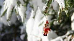 Small figure on real winter tree - stock footage