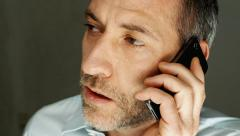 Businessman on the mobile phone - speaking Stock Footage