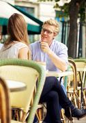 cute guy listening to his girlfriend - stock photo