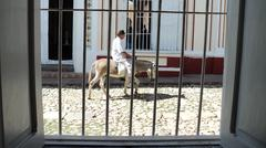 Stock Photo of Cuba, Trinidad, streetview, man with donkey