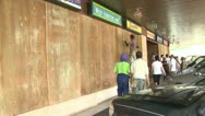 Stock Video Footage of Boarding Up Windows Ahead of Hurricane