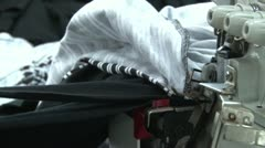 Textile Garment Factory Workers: CU feeding striped fabric into sewing machine Stock Footage