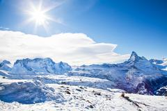 winter swiss landscape on switzerland hills with mountain matterhorn - stock photo