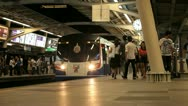 BTS train departing from platform station, Bangkok, Thailand Stock Footage
