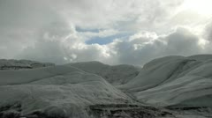 Time-lapse of clouds over an icy landscape in Alaska, USA  - stock footage