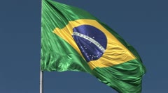 Brazilian flag blowing in the wind. Zoom out. Stock Footage