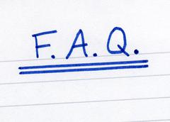 FAQ, frequently asked questions abbreviation, written on white paper. - stock photo
