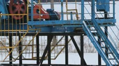 Oil production in the winter. Oil pumps - stock footage