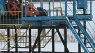 Stock Video Footage of Oil production in the winter. Oil pumps
