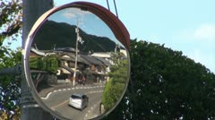 Old wooden buildings in a traffic mirror in Japan Stock Footage