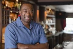 African American owner standing in bar Stock Photos