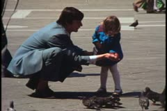 Montage of faces, Venice, Italy, 1970's, man feed pigeons, three boys Stock Footage