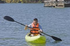 Chilean man paddling kayak Stock Photos