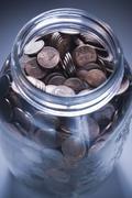 Jar full of pennies Stock Photos