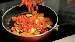 Add paprika into frying pan Stock Footage