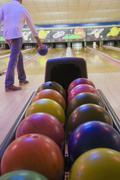 Stock Photo of Bowler throwing bowling ball down lane