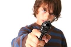 Child aim gun crime Stock Photos