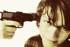 Stock Photo of child with gun crime