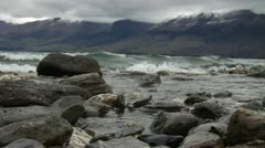 Waves on rocky beach - stock footage