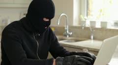 Burglar hacking laptop Stock Footage