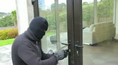 Burglar opening lock on door Stock Footage