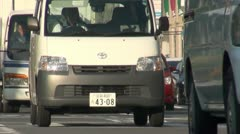 Rush hour traffic in urban Kyoto city Japan Stock Footage