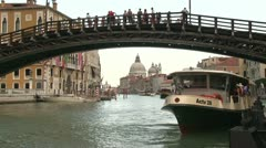 Water taxi loading in canal of Venice - stock footage