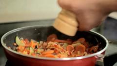 Season vegetables in the pan Stock Footage