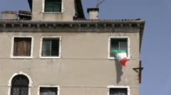Italian Flag hanging from old building Stock Footage