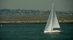 Sailboat Near Airport Stock Footage