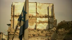 Israeli flag in ruins Stock Footage