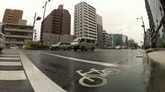 Traffic in downtown Kyoto on a rainy day (wide angle lens) Stock Footage