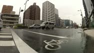 Stock Video Footage of Traffic in downtown Kyoto on a rainy day (wide angle lens)