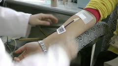Young people in voluntary blood donation - stock footage