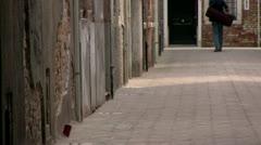 Man walking down back street - stock footage