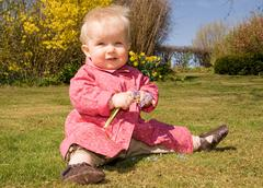 Stock Photo of baby girl garden flowers