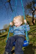 Stock Photo of child swing garden