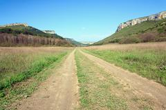 Spring crimean mountain landscape with road in valley (mangup ka Stock Photos